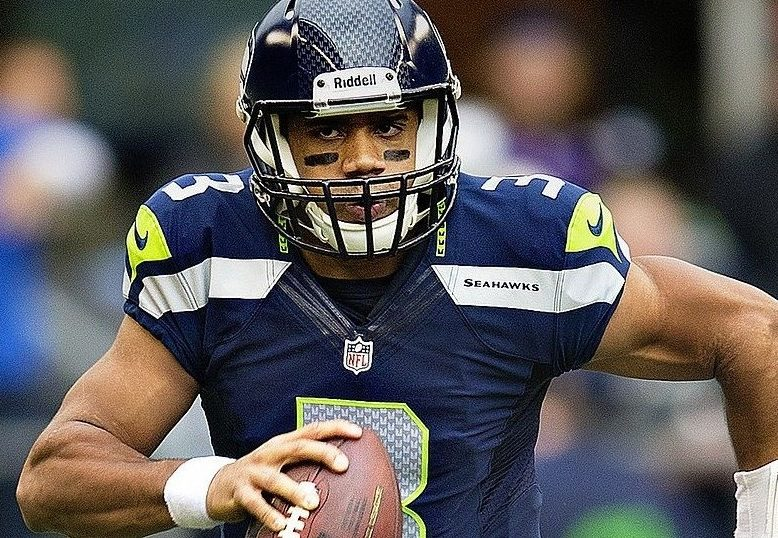 Russell Wilson scrambles against the Vikings (photo by Larry Maurer)